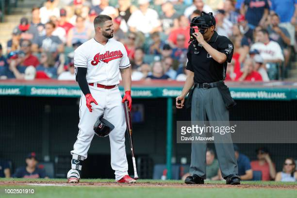 Yonder Alonso of the Cleveland Indians strikes out against the New York Yankees during the first inning at Progressive Field on July 13 2018 in...