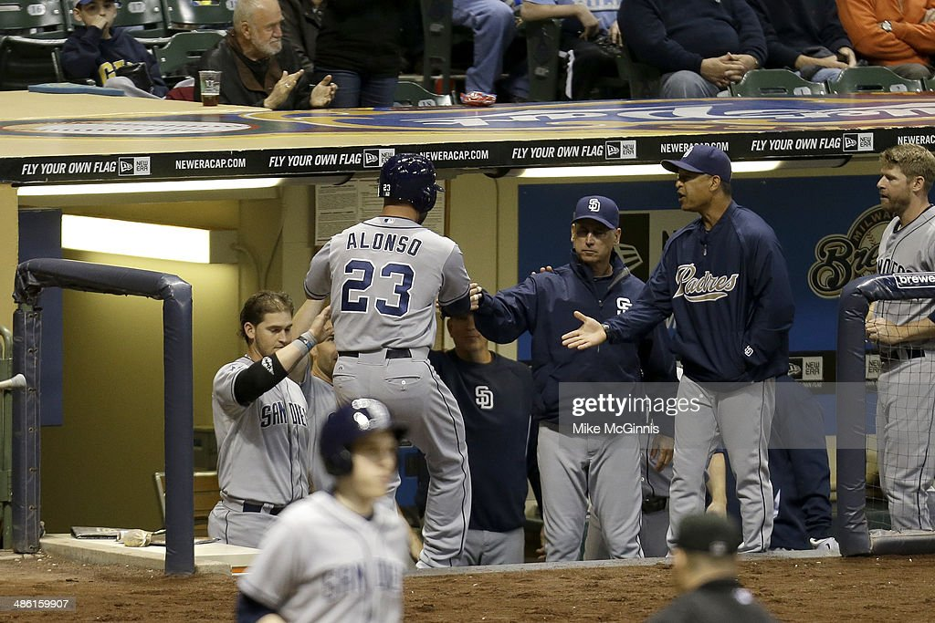 Yonder Alonso #23 of the San Diego Padres celebrates outside the dugout after reaching home plate in the top fifth inning against the Milwaukee Brewers at Miller Park on April 22, 2014 in Milwaukee, Wisconsin.