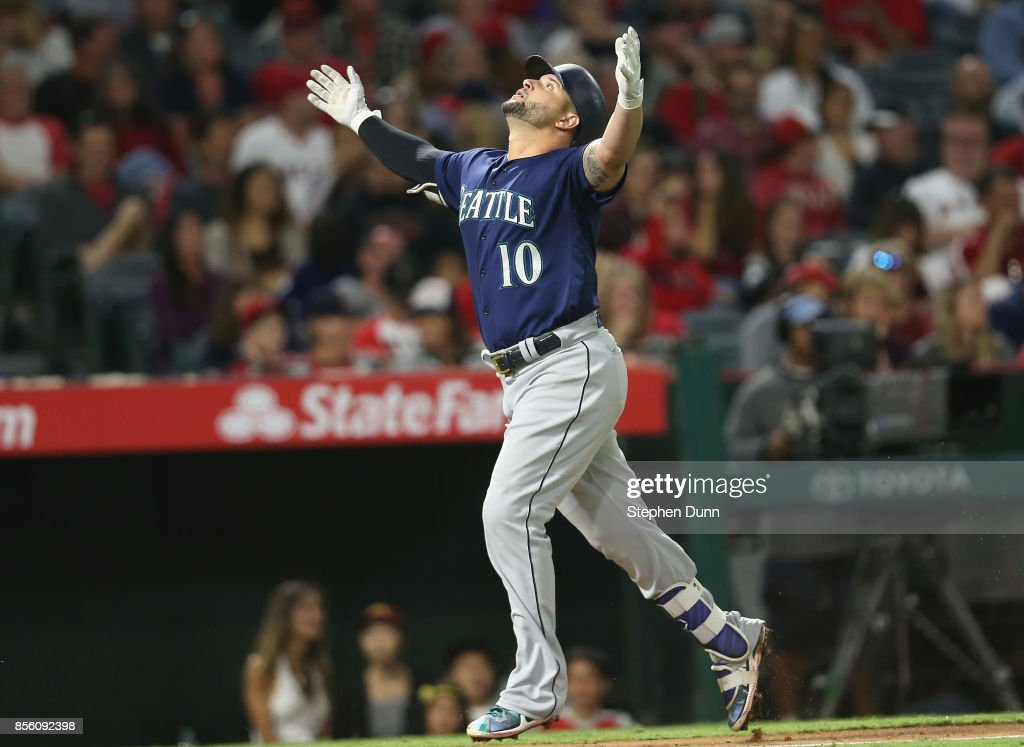 Yonder Alonso #10 of the Seattle Mariners celebrates as he runs to home after hitting a solo home run in the eighth inning against the Los Angeles Angels of Anaheim on September 30, 2017 at Angel Stadium of Anaheim in Anaheim, California.