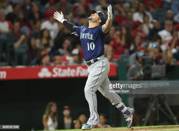 Yonder Alonso of the Seattle Mariners celebrates as he runs to home after hitting a solo home run in the eighth inning against the Los Angeles Angels...