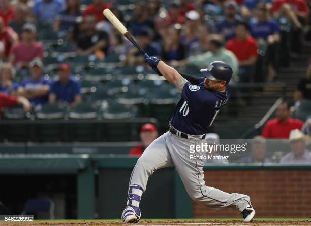 Yonder Alonso of the Seattle Mariners singles against the Texas Rangers in the second inning at Globe Life Park in Arlington on September 12 2017 in...