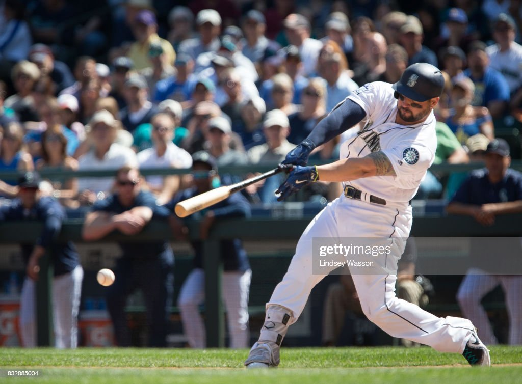 Yonder Alonso #10 of the Seattle Mariners singles in the fifth inning against the Baltimore Orioles to score Guillermo Heredia #5 at Safeco Field on August 16, 2017 in Seattle, Washington.
