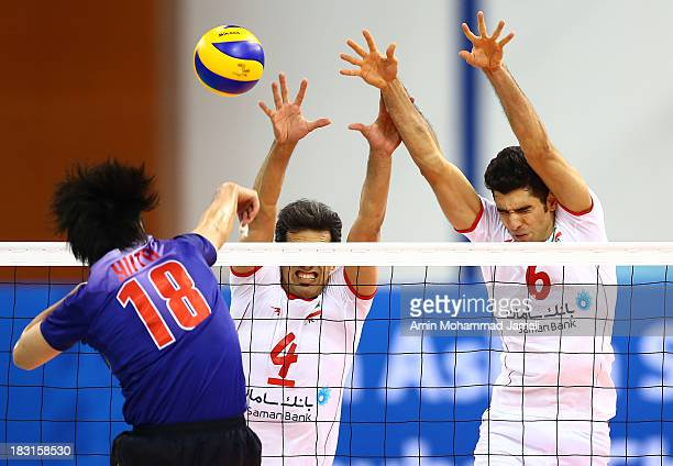 Yoneyama Yuta of Japan and Mir Saeed Marouf and Seyed Mohammad Mousavi during 17th Asian Men's Volleyball Championship between Iran And Japan on...