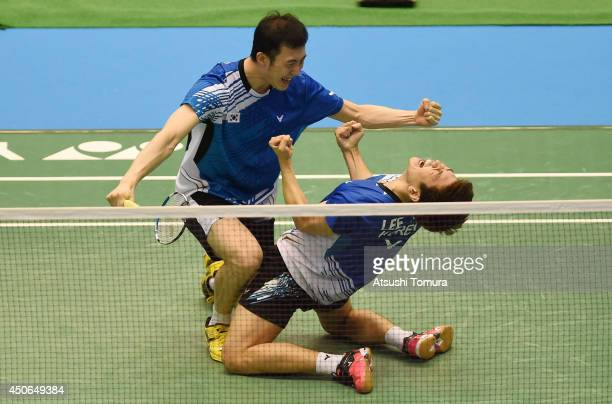 Yong Dae Lee and team mate Yeon Seong Yoo of Korea celebrate victory over Mohammad Ahsan and Hendra Setiawan of Indonesia during day six of Badminton...