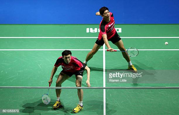 Yong Dae Lee and Yeon Seong Yoo of Korea in action against Mohammad Ahsan and Hendra Setiawan of Indonesia in the Men's Doubles semi final match...