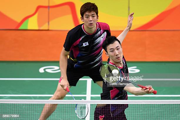 Yong Dae Lee and Yeon Seong Yoo of Republic of Korea compete against Vladimir Ivanov and Ivan Sozonov of Russia the Men's Doubless Play Stage Group A...