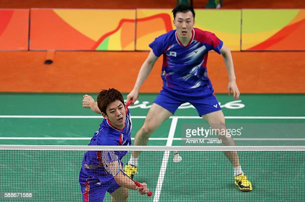 Yong Dae Lee and Yeon Seong Yoo of Republic of Korea competes against Sheng Mu Lee and Chia Hsin Tsai of Taipei in the badminton Men's Doubles Group...