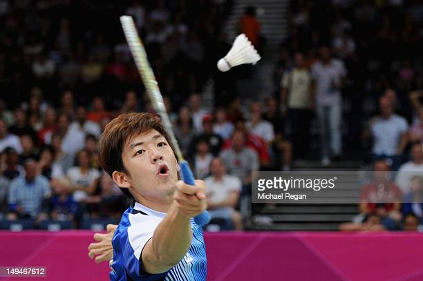 Yong Dae Lee of Korea returns a shot against Liliyana Natsir and Tontowi Ahmad of Indonesia during their Mixed Doubles Badminton on Day 2 of the...