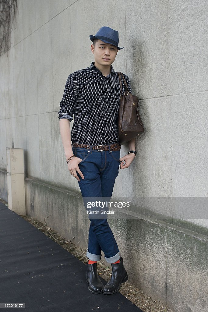 Yong Hao Yu wears sean White shoes, Zara jeans and hat, Tom Lee shirt and an Asos bag on day 4 of Paris Collections: Men on June 29, 2013 in Paris, France.