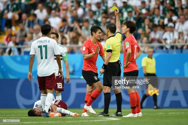 Yong Lee of Korea Republic is shown a yellow card by referee Milorad Mazic during the 2018 FIFA World Cup Russia group F match between Korea Republic...