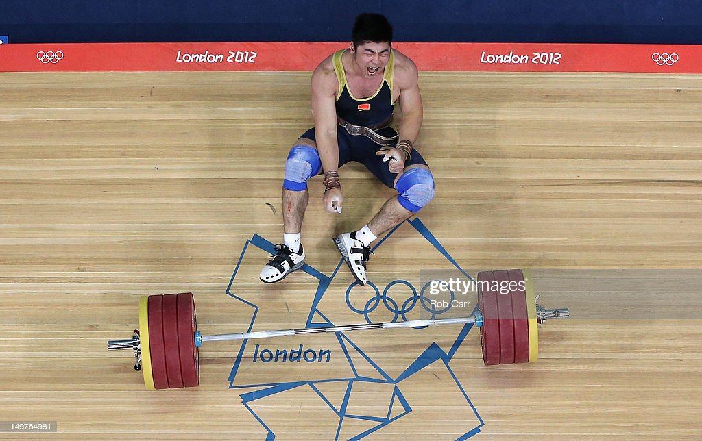 Yong Lu of China reacts after failing to lift during the Men's 85kg Weightlifting Final on Day 7 of the London 2012 Olympic Games at ExCeL on August 3, 2012 in London, England.
