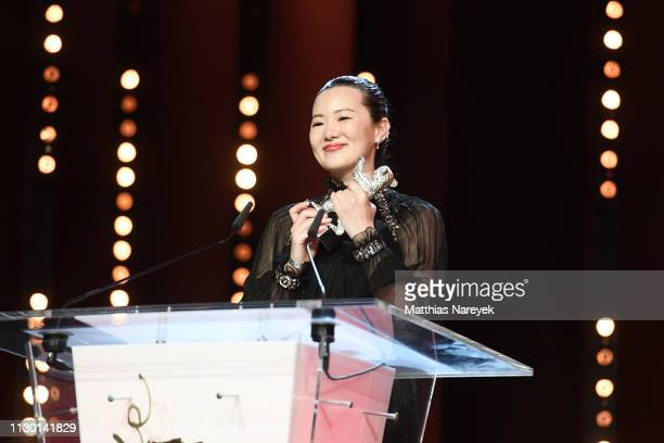 Yong Mei winner of Silver Bear for Best Actress for 'So long My Son' is seen on stage at the closing ceremony of the 69th Berlinale International...