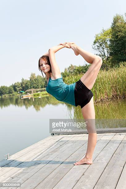 Yong woman performs stretching relaxation