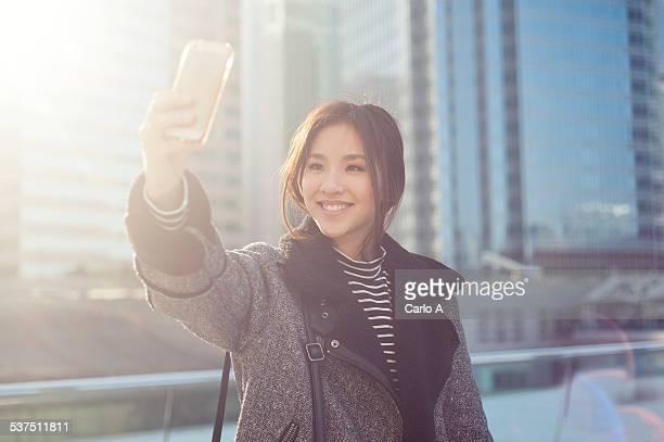 Yong woman taking selfie