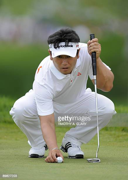 Yong-Eun Yang of South Korea lines up a putt during the final round of the 91st PGA Championship on August 16, 2009 at the Hazeltine National Golf...