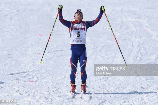 Yonggyu Kim of Korea celebrates his third place in the men's biathlon 12.5 km pursuit on day seven of the 2017 Sapporo Asian Winter Games at Nishioka...