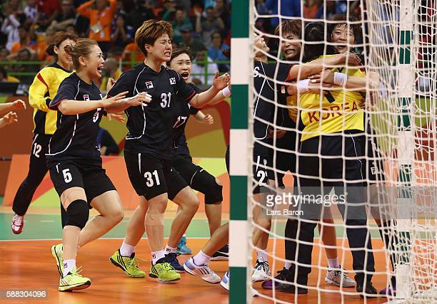 Yongran Oh of Korea celebrates with team mates during the Womens Preliminary Group A match between Norway and Angola at Future Arena on August 10,...