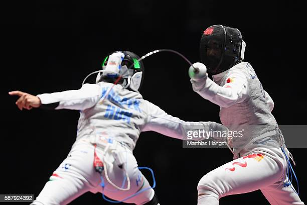 Yongshi Liu of China and Edina Knapek of Hungary compete during the women's individual foil on Day 5 of the Rio 2016 Olympic Games at Carioca Arena 3...