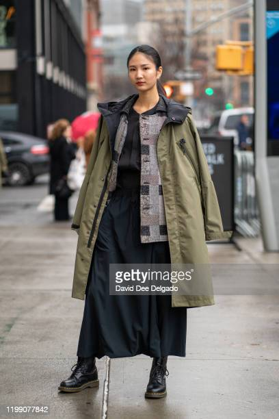Yongshin Chen wears a complete outfit by Oqliq to NYFW on February 6, 2020 in New York City.