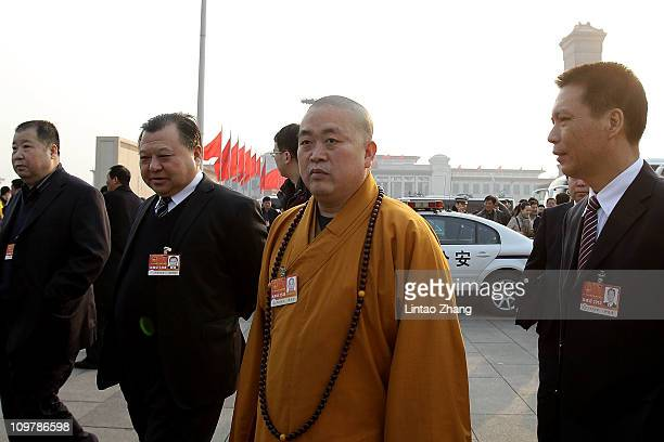 Yongxin Shi of the Shaolin Temple presided arrive at the Great Hall of the People before the opening session of the National People's Congress on...