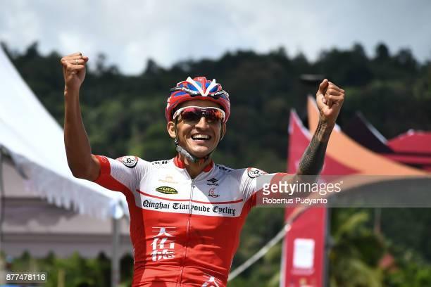 Yonnatta Alejandro Monsalve Pertsinidis of Venezuela and Qinghai Tianyoude Cycling Team China celebrates victory after winning stage 5 of the Tour de...