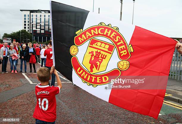 Manchester united flag getty images a yonng manchester united fan waves a manchester united flag prior to the barclays premier league voltagebd Image collections