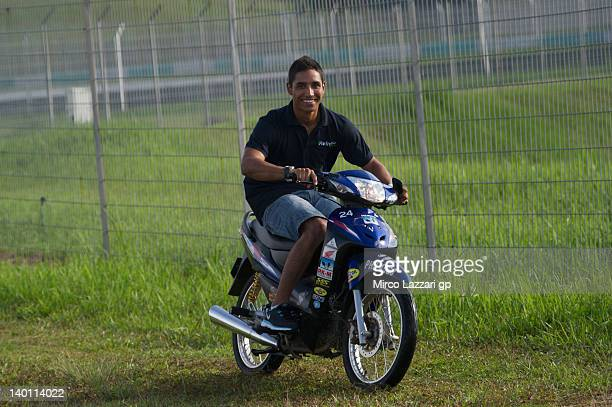 Yonny Hernandez of Columbia and Avintia Racing MotoGP rides a scooter during the first day of MotoGP Testing at Sepang Circuit on February 28 2012 in...