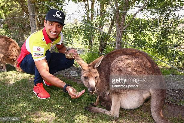 Yonny Hernandez of Octo Pramac Racing poses with a kangaroo at Maru Koala Animal Park ahead of the 2015 MotoGP of Australia at Phillip Island Grand...