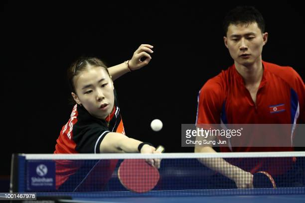 Jang WooJin of South Korea and Cha HyoSim of North Korea compete against Ho Kwan Kit and Lee HoChing of Hong Kong in the Mixed Double Quarterfinals...