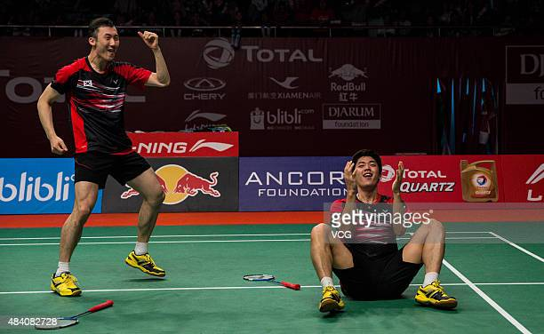 Yoo Yeon Seong and Lee Yong Dae of South Korea celebrate after winning Fu Haifeng and Zhang Nan of China in Men's Doubles match in 2015 BWF World...