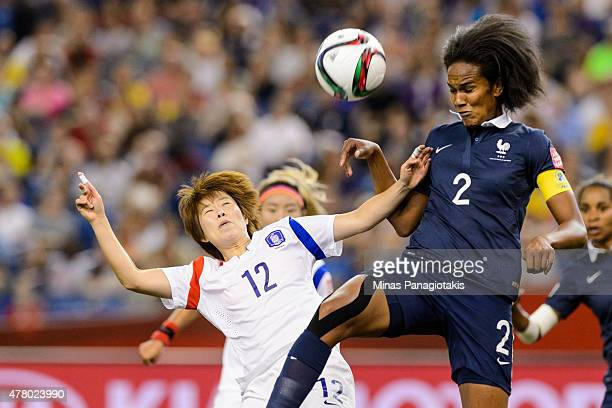 Yoo Younga of Korea Republic and Wendie Renard of France jump for the ball during the 2015 FIFA Women's World Cup Round of 16 match at Olympic...