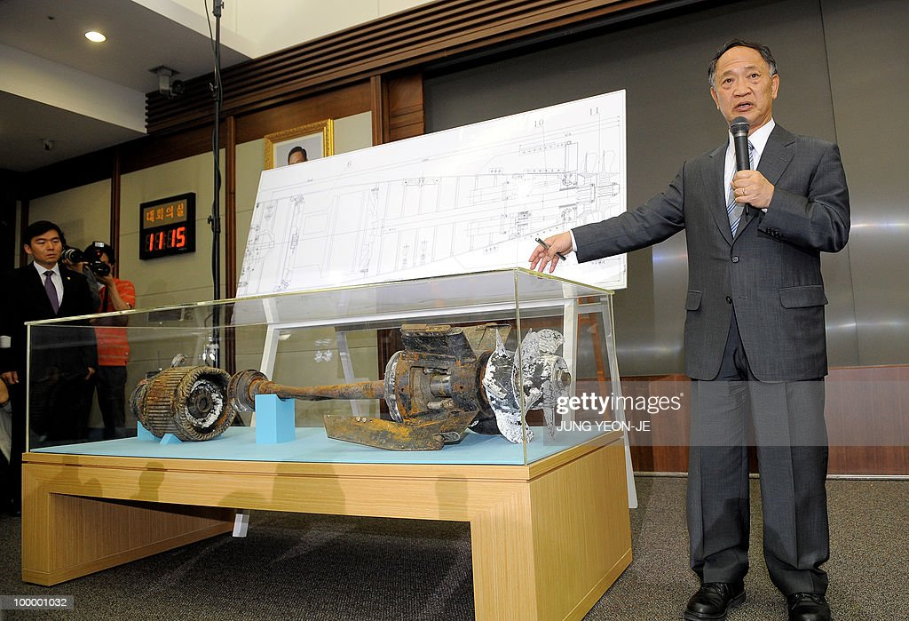 Yoon Duk-Yong (R), co-head of the team investigating the sinking of the South Korean warship Cheonan, talks next to torpedo parts salvaged from the Yellow Sea during a press conference at the Defense Ministry in Seoul on May 20, 2010. South Korea's president vowed 'resolute countermeasures' against North Korea after investigators concluded that it sank one of Seoul's warships with the loss of 46 lives. A multinational team investigating the March 26 sinking of the 1,200-tonne corvette said a torpedo fired by a North Korean submarine was to blame.