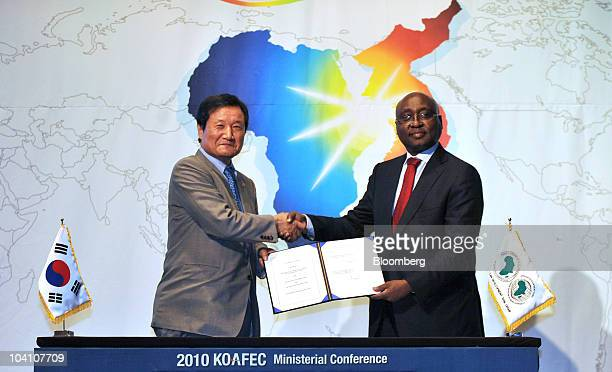 Yoon Jeung Hyun South Korea's minister of strategy and finance left shakes hands with Donald Kaberuka president of the African Development Bank...