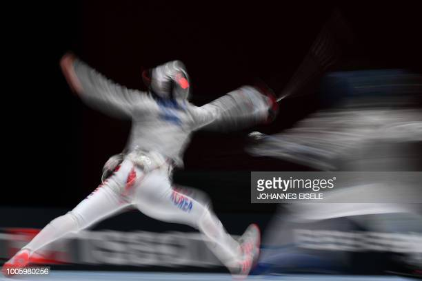 Yoon Jisu of South Korea competes against Lor Gulotta of Italy during the women's sabre team competition at the 2018 World Fencing Championships in...