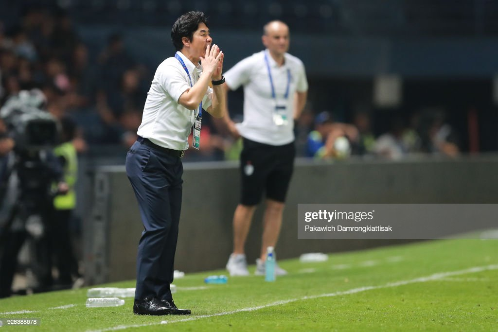 Yoon Jong Hwan, Cerezo Osaka head coach, gives instruction to Cerezo Osaka players during the AFC Champions League Group G match between Buriram United Football Club and Cerezo Osaka at Thunder Castle on March 6, 2018 in Buriram, Thailand.