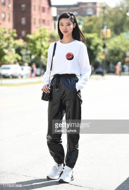 Yoon Young Bae is seen wearing an Urban Outfitters shirt and black pants outside the Tory Burch show during New York Fashion Week S/S20 on September...