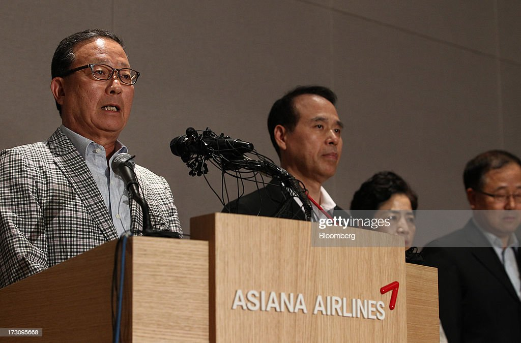 Yoon Young Doo, chief executive officer and president of Asiana Airlines Inc., speaks while company executives listen during a news conference at the company's headquarters in Seoul, South Korea, on Sunday, July 7, 2013. A Boeing Co. 777 flown by South Korea's Asiana Airlines crashed while landing in San Francisco yesterday, killing two people as passengers escaped down emergency slides before a fire swept through the plane. Yoon apologized for the crash and said that Asiana is struggling to confirm details of casualities through the U.S. authorities. Photographer: SeongJoon Cho/Bloomberg via Getty Images