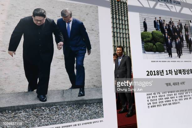 Yoon Youngchan a senior South Korean presidential secretary for public relations looks at posters advertising the summit between South Korean...