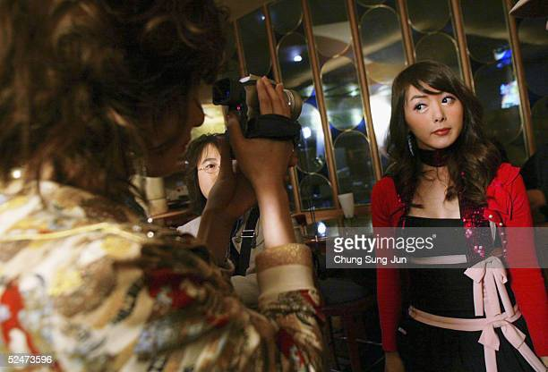 Yoona and Binu members of South Korea's first transgender group 'Lady' patricipates in the making of their music video on March 24 2005 in Seoul...