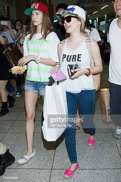 Yoona and Sunny of South Korean girl group Girls' Generation are seen upon arrival at Incheon International Airport on July 22 2013 in Incheon South...
