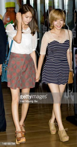 Yoona and Sunny of South Korean girl group Girls' Generation attend the 'A Millionaire On The Run' VIP screening on July 11, 2012 in Seoul, South...