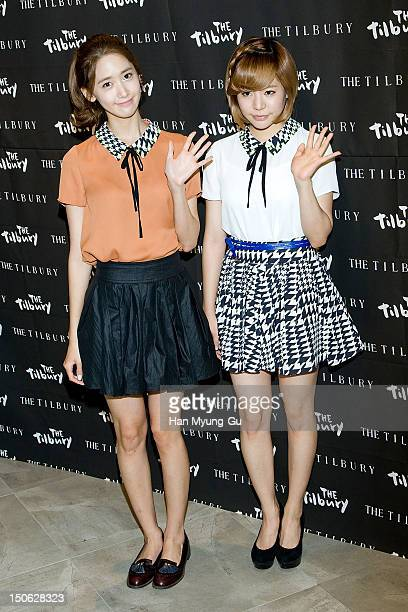 Yoona and Sunny of South Korean girl group Girls' Generation attend during the launch event of 'the Tilbury' at Lotte Department Store on August 23...