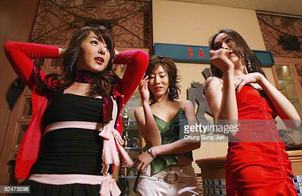 Yoona Binu and Sine members of South Korea's first transgender group 'Lady' patricipates in the making of their music video on March 24 2005 in Seoul...