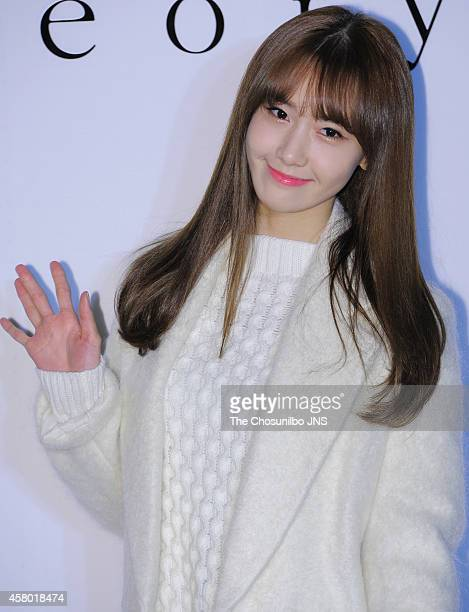 YoonA of Girls' Generation poses for photographs during the Theory flagship store 2nd anniversary event at Sinsadong on October 22 2014 in Seoul...
