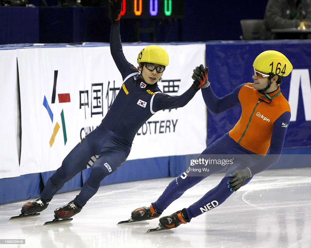 Yoon-Gy Kwak (L) of Korea shakes hands with Sjinkie Knegt of Netherlands after won in the Men's 5000m Relay Final during the day two of the ISU World Cup Short Track at the Oriental Sports Center on December 9, 2012 in Shanghai, China.
