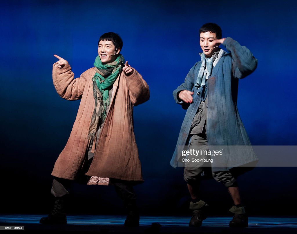 Yoon-Hak of Supernova and Lee-Teuk of Super Junior perform during the musical 'The Promise' press call at the National Theater of Korea Main Hall 'Hae' on January 8, 2013 in Seoul, South Korea.