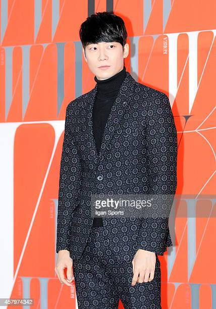 YoonHan poses for photographs during the W Korea campaign Love Your W party at Fradia on October 23 2014 in Seoul South Korea
