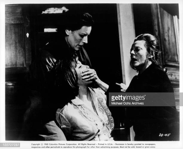 Yootha Joyce helps Tallulah Bankhead silence Stefanie Powers in a scene from the film 'Die Die My Darling' 1965