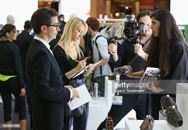 Yoox Federico Marchetti and Myriam Galletti speaks to designer Nathalie Trad at the Designer Showcase during the Vogue Fashion Dubai Experience 2015...