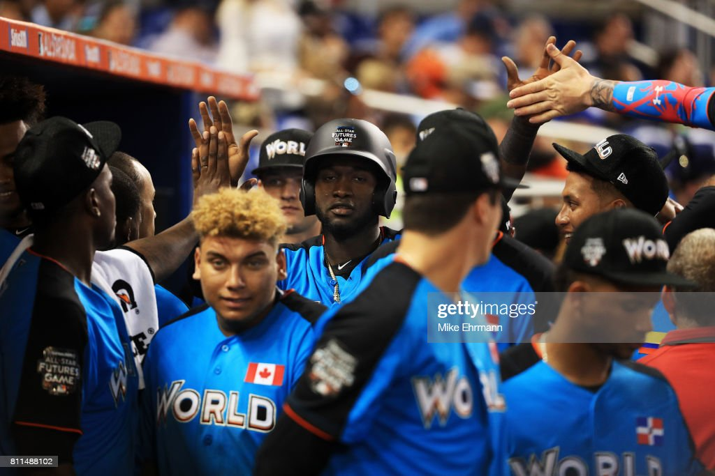 Yordan Alvarez #43 of the Houston Astros and the World Team celebrates in the dugout after scoring in the ninth inning during the SiriusXM All-Star Futures Game at Marlins Park on July 9, 2017 in Miami, Florida.